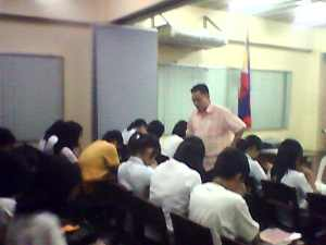 Leading the college students of Imus Institute in prayer