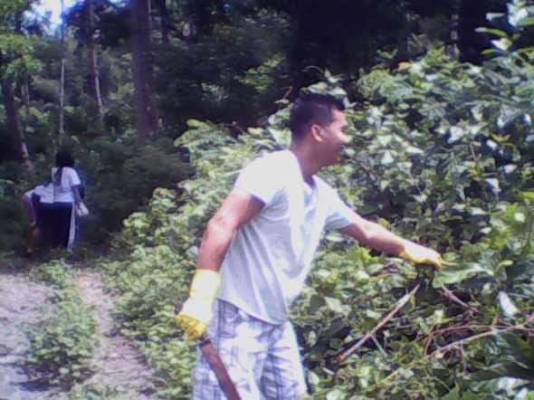 "Bro. Crisant ""Kuya Sant"" Dema-ala clearing some wild vines from area 4"